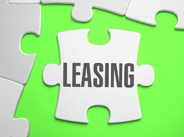 Leasing - Jigsaw Puzzle with Missing Pieces. Bright Green Background. Close-up. 3d Illustration.