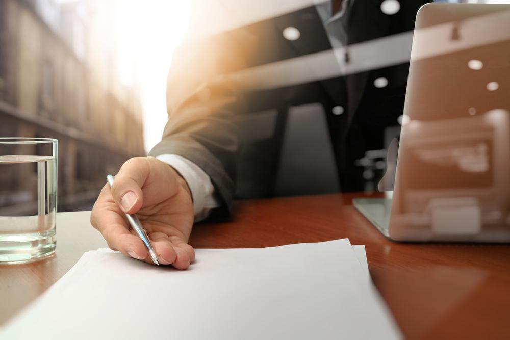 double exposure of businessman or salesman handing over a contract on wooden desk-1