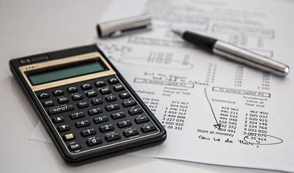 black-calculator-near-ballpoint-pen-on-white-printed-paper-53621 (1)