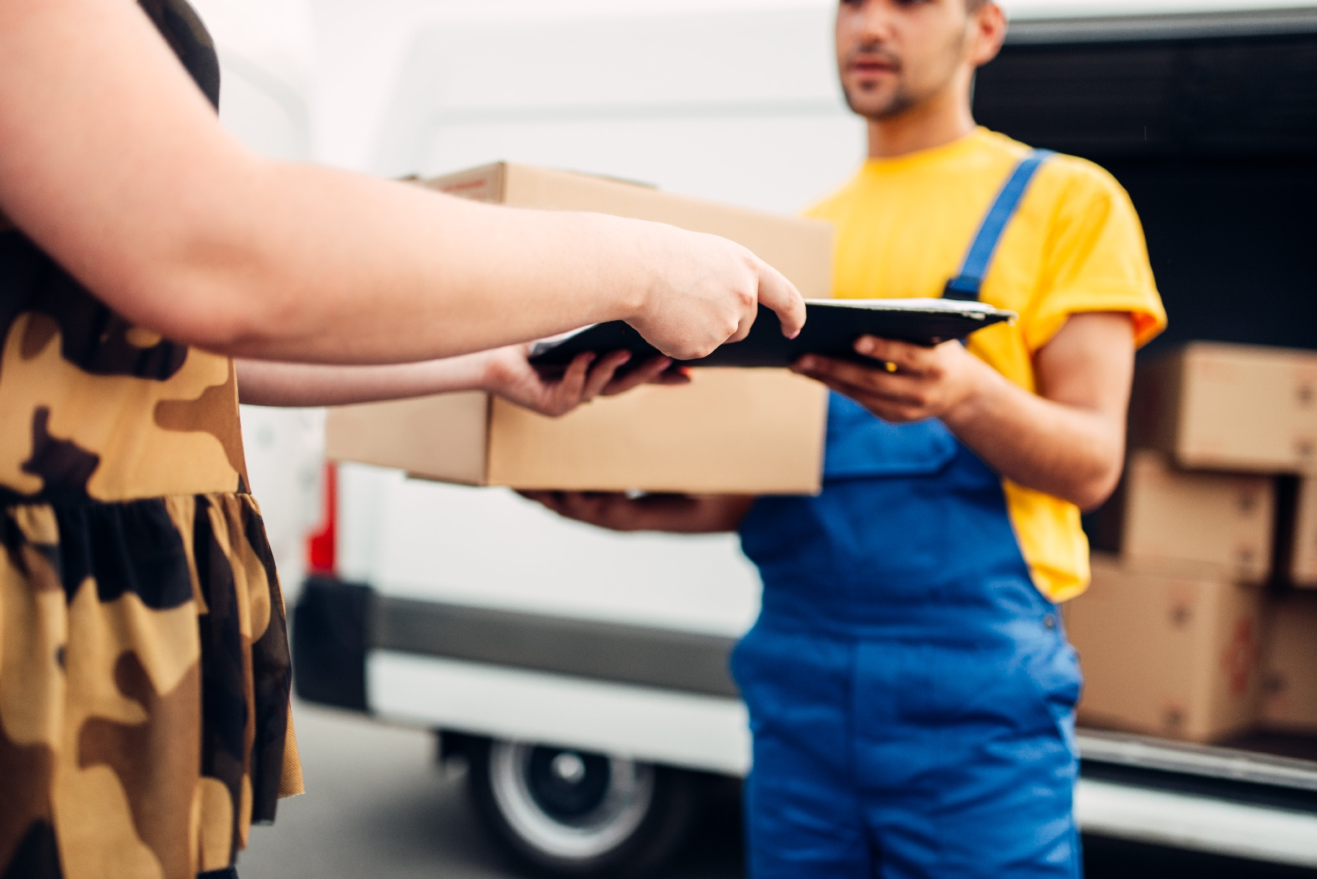 cargo-delivery-courier-gives-parcel-to-the-client-PGN2Y6E-1