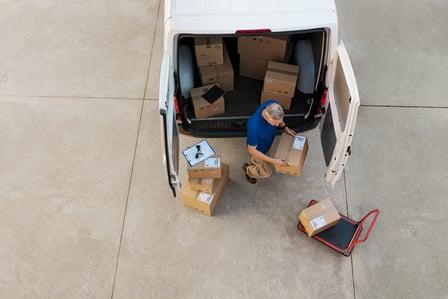 courier-delivering-parcel-PQZHBGE