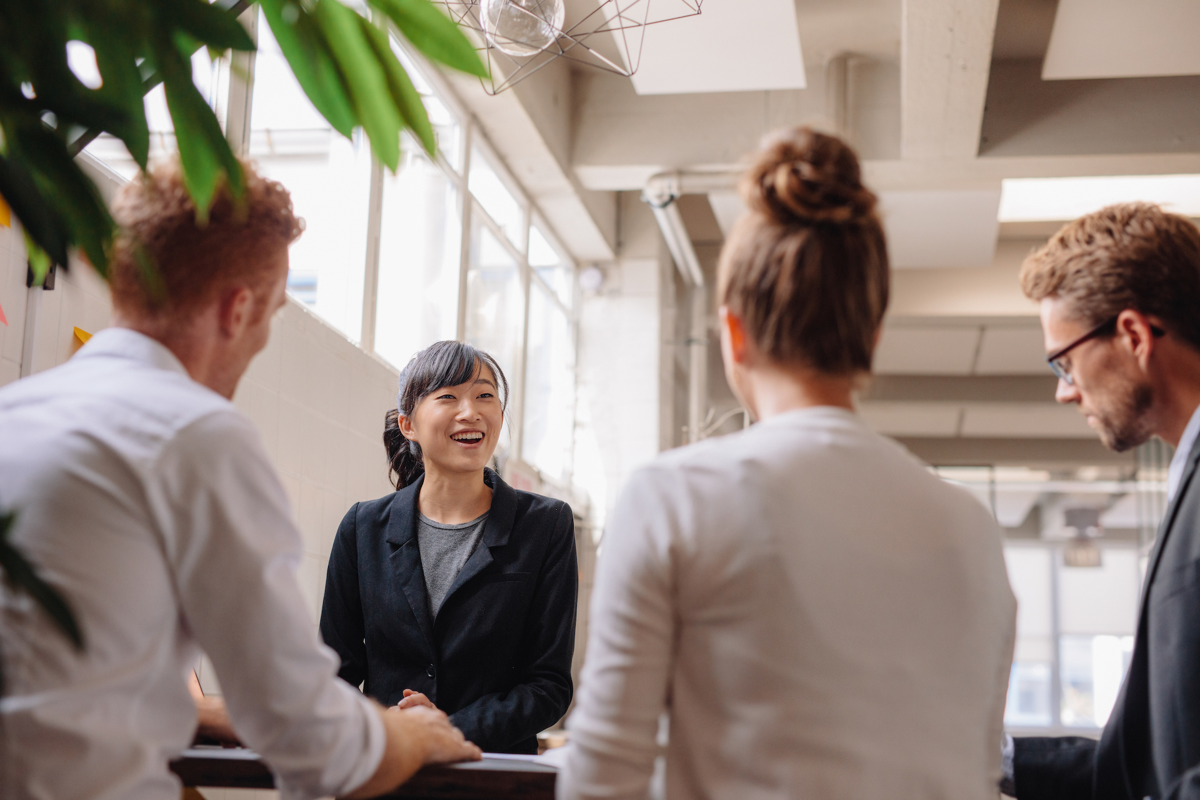 diverse-group-of-business-people-having-meeting-PBNRU9G-1
