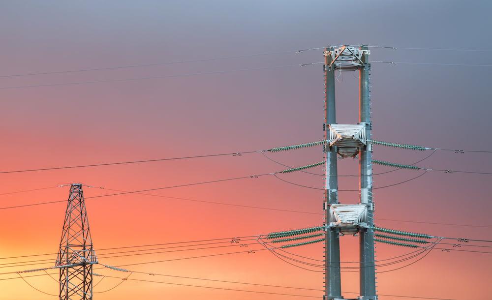 high-voltage-power-transmission-line-on-sunset-PD463HB