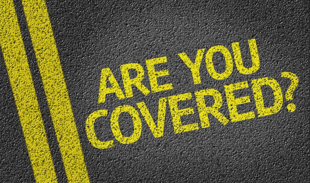 Are you Covered? written on the road.jpeg