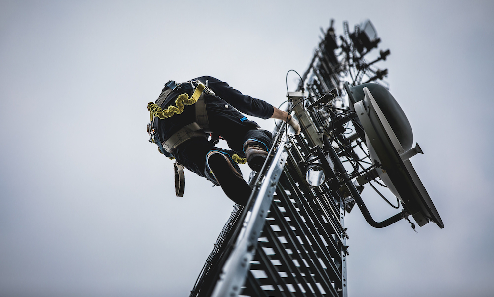 telecom-worker-climbing-antenna-tower-PEZMGB3
